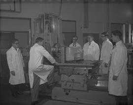 Mechanical Technology, 1966; six men in lab coats using a horizontal surfacing and boring machine