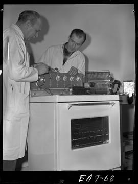 BC Vocational School image of an instructor and student in the Appliance Servicing program; worki...