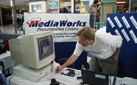 MediaWorks booth at BCIT open house (?) [3 of 5 photographs]