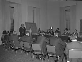 Hotel Motel Restaurant Administration Program; a man standing at podium lecturing; audience sitti...