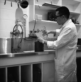 BCVS Graphic arts ; a man preparing darkroom chemicals [1 of 3]
