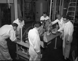 Mechanical Technology, 1966; six men in white overalls using machinery [1 of 2]