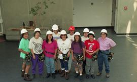 Pre-trade Aboriginal women; students wearing hard hats and tool belts [8 of 8 photographs]