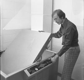 BCVS Graphic arts ; man using a Nuarc plate maker [2 of 2]