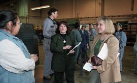 BCIT women in trades; steel fabrication, BCIT staff members and VIPs talking to students in unifo...