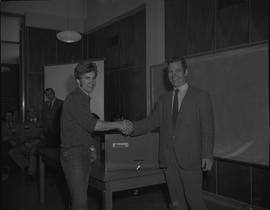 Heavy Duty Mechanics presentation of a tool box from an instructor to a student, 1971