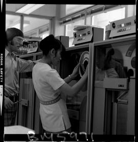 BCIT Business Management image of a women loading a computer, IBM 3420, magnetic tape drive with ...