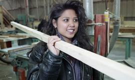 BCIT Women in Trades; carpentry, woman carrying a piece of wood [5 of 5 photographs]