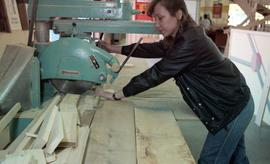 BCIT Women in Trades; carpentry, woman using band saw [1 of 2 photographs]