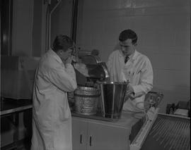 Mining, 1966; two men in lab coats testing mining samples [3 of 3]
