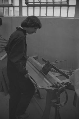 Pacific Vocational Institution ; trade student using carpentry equipment [1 of 2]