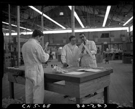 B.C. Vocational School image of Carpentry Trades students at a workbench in the Carpentry shop, l...