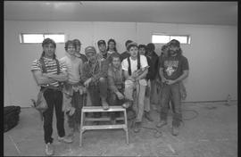 Students holding power tools and posing for a group shot during gym construction [5 of 8 photogra...