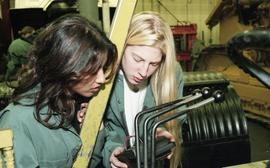 BCIT women in trades; heavy duty, students in uniforms using mechanical tools and equipment [14 o...