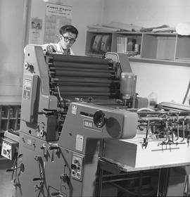BCVS Graphic arts ; a man working on a printing press