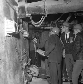 Forestry, Wood fiber BCIT tour, November 26, 1965; men wearing hard hats in a factory