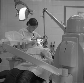 BC Vocational School Dental Assistant program ; a student performing a dental cleaning on a patient