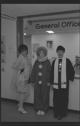 General Office staff dressed as a housewife (?), clown, and priest [4 of 11 photographs]