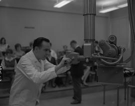 Medical radiography, 1967; man in a lab coat using radiography apparatus