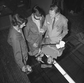 BCVS Glazier program ; three men looking at a piece of glass [1 of 2]