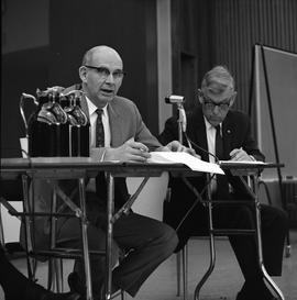 CVA Convention, 1969 ; two men sitting at a table with microphones