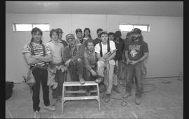 Students holding power tools and posing for a group shot during gym construction [4 of 8 photogra...