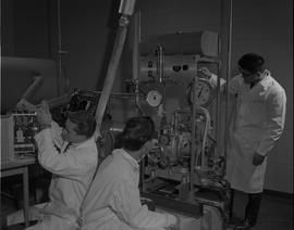 Mechanical Technology, 1966; three men in lab coats using a equipment