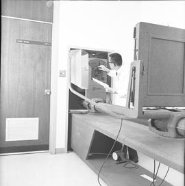 BCVS Graphic arts ; a man adjusting settings for a dark room camera [1 of 2]