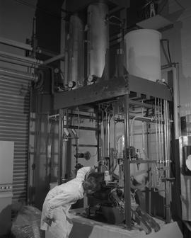 Forest Products, 1966; a man in lab coat using Sumner forest product equipment [2 of 3]