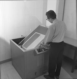 BCVS Graphic arts ; a man using a Nuarc plate maker