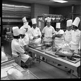 BC Vocational School Baking Course ; Mr. Buckley, cooking instructor, demonstrating to new studen...