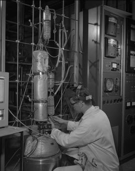 Gas and Oil, 1966; man wearing a safety mask using testing equipment [1 of 2]