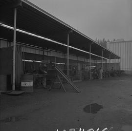 Welding, Nanaimo, 1968; work yard; welders working under a covered area [2 of 2]