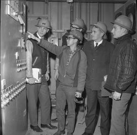 Forestry, Wood fiber BCIT tour, November 26, 1965; one man showing four men forestry equipment