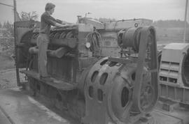 Pacific Vocational Institution ; trade student working on large machinery [1 of 3]