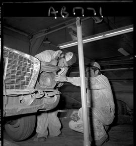 BC Vocational School image of Autobody program students working on a vehicle in the shop [3 of 8 ...