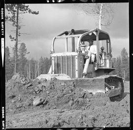Heavy duty equipment operator, Nanaimo ; man operating a bulldozer moving dirt [1 of 9]
