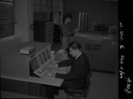 Business Management, 1964; man in a suit working at an IBM computer; students working at computer...