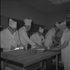 Tow boat cook course; students chopping vegetables