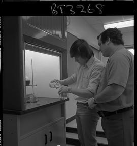 BCVS image of a Basic Training Skills Development (BTSD) student at a chemistry booth pouring a l...