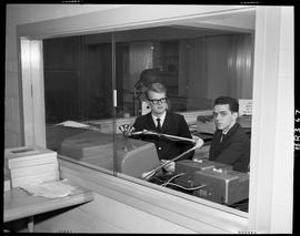 B.C. Vocational School image of two Broadcasting students in a broadcasting booth