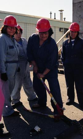 Pre-trade Aboriginal women; gas, students in uniforms and hard hats taking turns to use tools on ...