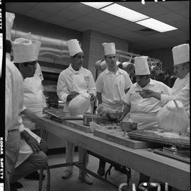 BC Vocational School Baking Course ; student asking the instructor, Mr. Buckley, a question ; stu...