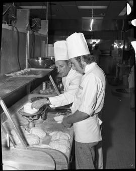 BC Vocational School Cook Training Course ; instructor weighing dough while student observes