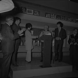 Governor General the Right Honourable Roland Michener standing at a podium and shaking hand with ...