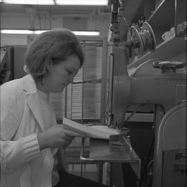 BCVS Graphic arts ; woman using a book binding machine [3 of 3]