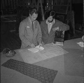 BCVS Glazier program ; two men looking at blueprints [1 of 3]