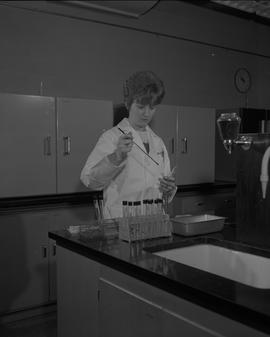 Food Processing Technology, 1966; woman wearing a lab coat cleaning(?) test tubes ; test tubes in...