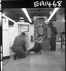 BC Vocational School image of an instructor and students in the Appliance Servicing program; back...