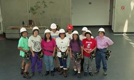 Pre-trade Aboriginal women; students wearing hard hats and tool belts [7 of 8 photographs]